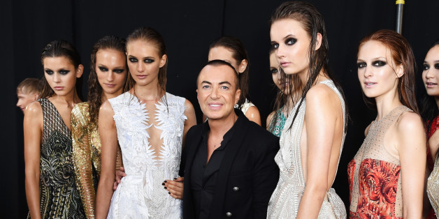LONDON, ENGLAND - SEPTEMBER 19:  Julien MacDonald (C) poses backstage with models at the Julien MacDonald Spring/Summer 2016 Collection during London Fashion Week at Smithfields Market on September 19, 2015 in London, England.  (Photo by David M. Benett/Getty Images for Julien MacDonald)
