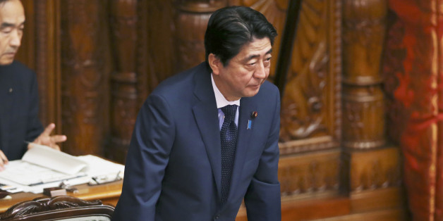Japanese Prime Minister Shinzo Abe acknowledges after a censure motion against him filed by an opposition party was rejected during the upper house plenary diet session in Tokyo Friday, Sept. 18, 2015. The censure motion was filed by the opposition to block contentious security bills that Abe's ruling party is eager to get final approval by the upper house. The bills would ease restrictions on what the military can do, a highly sensitive issue in a country where many take pride in the postwar pa