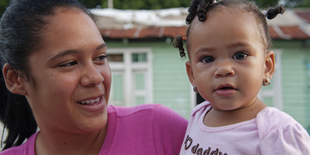 Very cute baby girl and her mother, in the town of Barahona, Dominican Republic