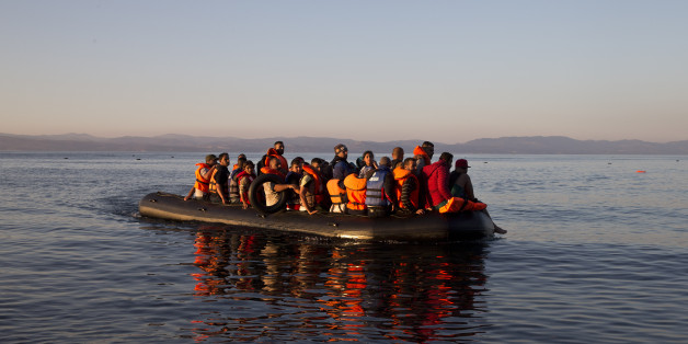 Syrian refugees arrive aboard a dinghy after crossing from Turkey, to the island of Lesbos, Greece. Friday, Sept. 18, 2015. More than 250,000 people have reached Greece clandestinely so far this year, the vast majority of them Syrians or Afghans fleeing conflict at home. (AP Photo/Petros Giannakouris)