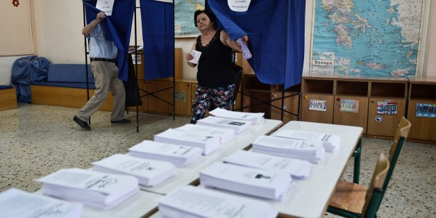 A woman exits a polling booth prior to cast her ballot in central Athens on September 20, 2015. Over 9.8 million Greeks were registered to vote in an election that will select a new government to implement a three-year bailout adopted by the country's parliament last month.  AFP PHOTO/ LOUISA GOULIAMAKI        (Photo credit should read LOUISA GOULIAMAKI/AFP/Getty Images)