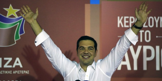 Alexis Tsipras the leader of left-wing Syriza party waves to his supporters after the election results at the party's main electoral center in Athens, Sunday, Sept. 20, 2015. Jubilant supporters of Alexis Tsipras' left-wing Syriza party cheered, waved party flags and danced Sunday after the party comfortably won Greece's third national vote this year despite a party rebellion over his acceptance of a painful third international bailout.(AP Photo/Lefteris Pitarakis)