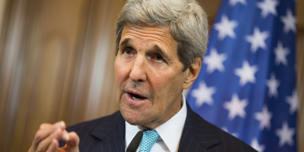 U.S. Secretary of State John Kerry gestures during a news conference with German Foreign Minister Frank-Walter Steinmeier about the ongoing crisis in Syria, at Villa Borsig, Berlin, Sunday, Sept. 20, 2015. (AP Photo/Evan Vucci, Pool)