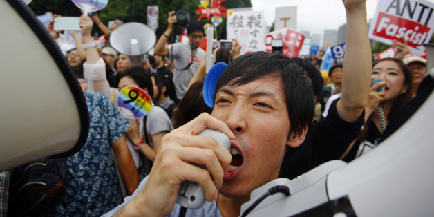 Protesters shout slogans during a rally in front of the National Diet building in Tokyo, Sunday, Aug. 30, 2015. Thousands of Japanese protested outside the parliament a set of security bills designed to expand the role the country's military. The bills - a cornerstone of Prime Minister's Shinzo Abe's move to shore up Japan's defenses in the face of growing threats in the region - are expected to pass next month despite criticism they undermine Japan's post-war pacifism. (AP Photo/Shizuo Kam