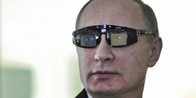 "Russian President Vladimir Putin wears special glasses as he visits a research facility of the St. Petersburg State University in St. Petersburg, Russia, on Monday, Jan. 26, 2015. In televised comments after a meeting with students in St. Petersburg, President Vladimir Putin said that Ukraine's army was at fault for the increase in violence and accused it of using civilians as ""cannon fodder"" in the conflict. ""(Ukraine's army) is not even an army, it's a foreign leg"