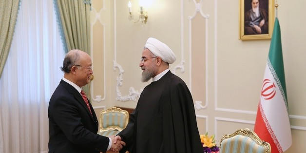 TEHRAN, IRAN - SEPTEMBER 20: International Atomic Energy Agency (IAEA) Director General Yukiya Amano (L) is welcomed by Iranian President Hassan Rouhani (R) prior to their meeting at the presidential palace in Tehran, Iran on September 20, 2015. (Photo by Pool/Iranian Presidency Press Office /Anadolu Agency/Getty Images)