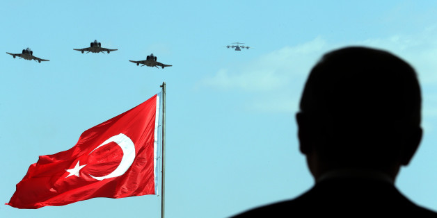 ANKARA, TURKEY - AUGUST 30:   President of Turkey Recep Tayyip Erdogan watches the performance of the aerobatic demonstration team of the Turkish Air Force 'Turkish Stars' in Ankara, Turkey on 30 August, 2014. (Photo by Kayhan Ozer/Anadolu Agency/Getty Images)