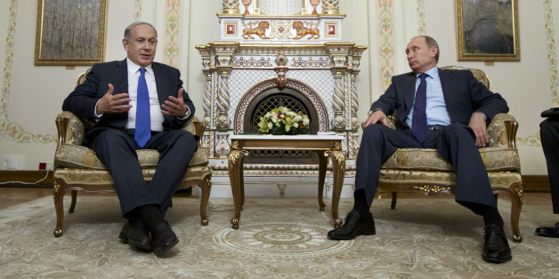 Russian President Vladimir Putin listens to Israeli Prime Minister Benjamin Netanyahu, left, during their meeting in the Novo-Ogaryovo residence, outside Moscow, Russia, Monday, Sept. 21, 2015. (AP Photo/Ivan Sekretarev, Pool)