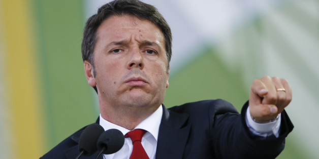 Italian Premier Matteo Renzi gestures as he delivers his speech on the occasion of the Italian Agriculture day, at the Expo world fair in Rho, near Milan, Italy, Tuesday, Sept. 15, 2015. (AP Photo/Luca Bruno)