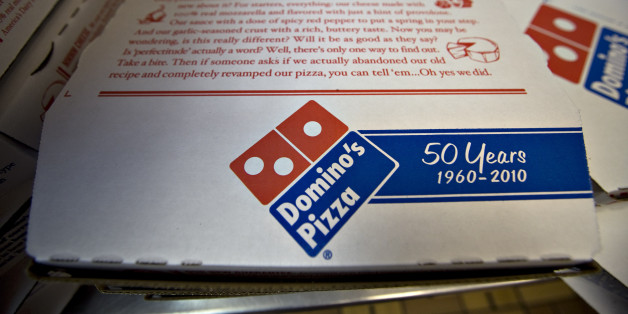 Pizza boxes sit inside a Domino's Pizza franchise on 89th Street in New York, U.S., on Wednesday, Jan. 13, 2010. Domino's Pizza Inc., the second-largest U.S. pizza maker, said Internet orders make up the fastest-growing part of its business, accounting for as much as 30 percent of sales in some markets. Photographer: Daniel Acker/Bloomberg via Getty Images