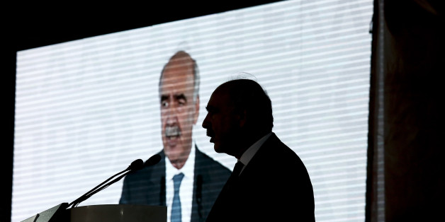 Evangelos Meimarakis, leader of the New Democracy Party of Greece, is silhouetted against a video screen as he speaks during a pre-election rally in Athens, Greece, on Thursday, Sept. 17, 2015. Alexis Tsipras stepped down on Aug. 20 after eight months in power, announcing new parliamentary elections following the political turmoil resulting from his government's signing of a third bailout agreement with Greece's creditors in August. Photographer: Kostas Tsironis/Bloomberg via Getty Images