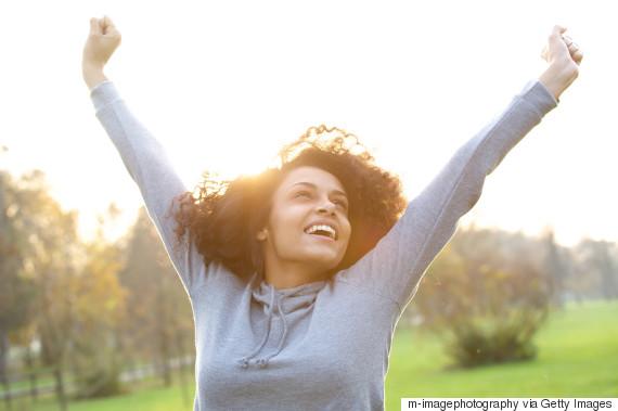 black woman happy outside
