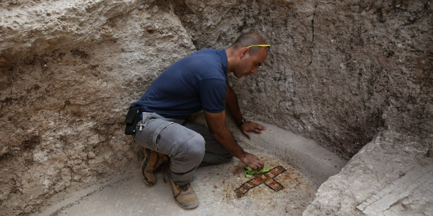 Israeli archeologist Dan Shachar, of the Israel Antiquities Authority, works on September 21, 2015 at the site of excavations where a large Mausoleum was recently uncovered located a short distance from the central Israeli city of Modiin. In recent weeks the Israel Antiquities Authority, together with local residents and young people, has been conducting an unusual archaeological excavation in search of the real location of the Tomb of the Maccabees.  According to historical sources, the Maccabees  Matityahu the Hasmonean and his five sons, from the ancient city of Modi'in, led the uprising against Greek rule and were responsible for cleansing the impurity from the Second Temple. AFP PHOTO/GALI TIBBON