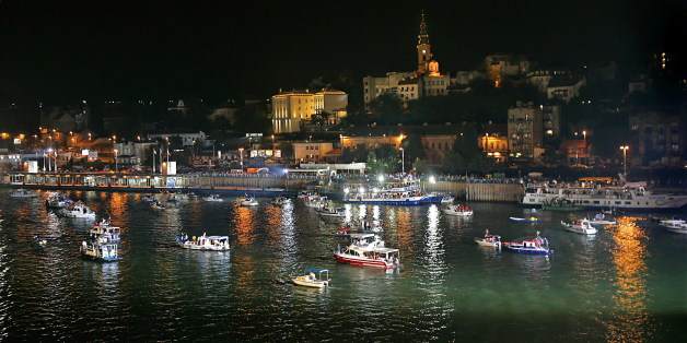 """Parade of ships, boats and jets on Belgrade Rivers. Belgrade Port is swarming with people in costumes, from Elvises, sailors to gentleman with top hats and ladies in beautiful night gowns.  (By Magelan Travel)  <a href=""""http://www.belgrade-hotels-serbia.travel"""" rel=""""nofollow"""">www.belgrade-hotels-serbia.travel</a>"""