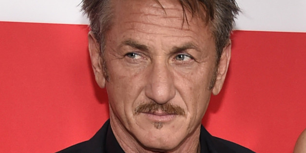 "Sean Penn arrives at the Los Angeles premiere of ""The Gunman"" at Regal Cinemas LA LIVE on Thursday, March 12, 2015. (Photo by Chris Pizzello/Invision/AP)"