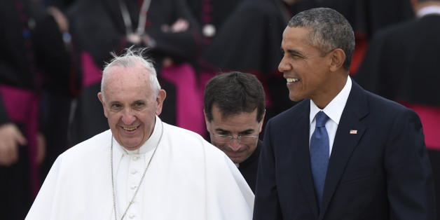 Pope Francis, left, walks with President Barack Obama, right, after arriving at Andrews Air Force Base, Md., Tuesday, Sept. 22, 2015. The Pope is spending three days in Washington before heading to New York and Philadelphia. This is the Pope's first visit to the United States. (AP Photo/Susan Walsh)