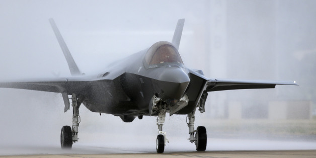 An F-35 arrives at it new operational base Wednesday, Sept. 2, 2015, at Hill Air Force Base, in northern Utah. Two F-35 jets touched down Wednesday afternoon at the base, about 20 miles north of Salt Lake City. A total of 72 of the fighter jets and their pilots will be permanently based in Utah. (AP Photo/Rick Bowmer)