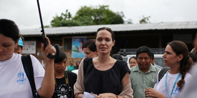 US actress and UNHCR Goodwill Ambassador Angelina Jolie (C) visits Jan Mai Kaung refugee camp in Myitkyina, Kachin State in Myanmar on July 30, 2015.  Jolie flew into Myanmar for a humanitarian visit, becoming the latest in a growing list of celebrities who have travelled to the former junta-run nation.    AFP PHOTO / Hkun Latt        (Photo credit should read HKUN LATT/AFP/Getty Images)