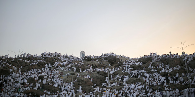 Muslim pilgrims pray on a rocky hill called the Mountain of Mercy, on the Plain of Arafat, near the holy city of Mecca, Saudi Arabia, Wednesday, Sept. 23, 2015 during the hajj pilgrimage. Mount Arafat, marked by a white pillar, is where Islam's Prophet Muhammad is believed to have delivered his last sermon to tens of thousands of followers some 1,400 years ago, calling on Muslims to unite. (AP Photo/Mosa'ab Elshamy)