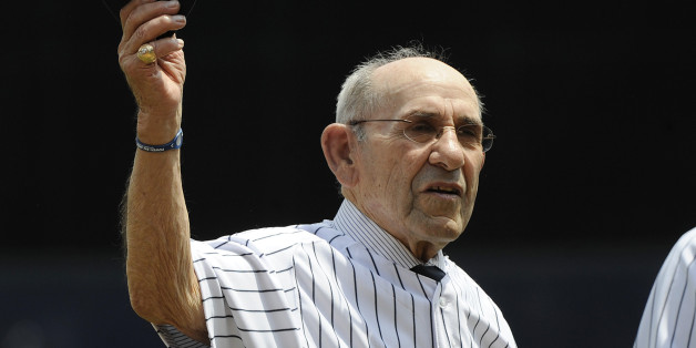 Former New York Yankees catcher Yogi Berra tips his cap during Old Timers' Day ceremonies Sunday, June 26, 2011 at Yankee Stadium in New York. (AP Photo/Bill Kostroun)