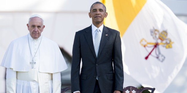 US President Barack Obama and Pope Francis stand during an arrival ceremony on the South Lawn of the White House in Washington, DC, September 23, 2015. More than 15,000 people packed the South Lawn for a full ceremonial welcome on Pope Francis' historic maiden visit to the United States. AFP PHOTO / JIM WATSON        (Photo credit should read JIM WATSON/AFP/Getty Images)