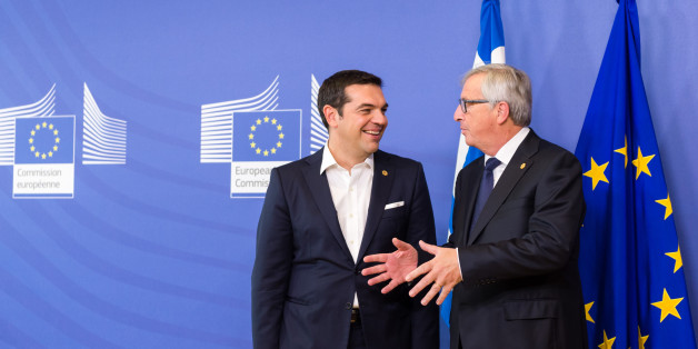 European Commission President Jean-Claude Juncker, right, welcomes Greece's Prime Minister Alexis Tsipras upon his arrival at the EU Commission headquarters in Brussels on Wednesday, Sept. 23, 2015. The European Union hopes to provide more funds for refugees and agree short and long term measures to confront the migration crisis. (AP Photo/Geert Vanden Wijngaert)