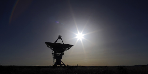 The sun sets behind an antenna at the National Radio Astronomy Observatory's Very Large Array, Tuesday, March 3, 2015, in Socorro County, N.M. (AP Photo/Patrick Semansky)