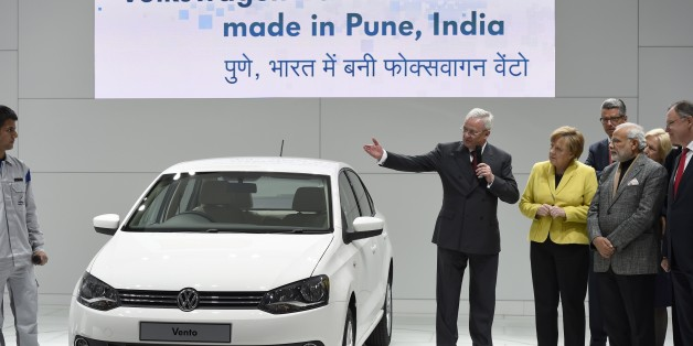 German Chancellor Angela Merkel (5th R) and Indian Prime Minister Narendra Modi (3rd R) listen to Martin Winterkorn (C), CEO of German car maker Volkswagen (VW), presenting a Volkswagen Vento car made in India, at the Hannover Messe industrial trade fair in Hanover, central Germany on April 13, 2015. India is the partner country of this year's trade fair running until April 17, 2015. AFP PHOTO / TOBIAS SCHWARZ        (Photo credit should read TOBIAS SCHWARZ/AFP/Getty Images)