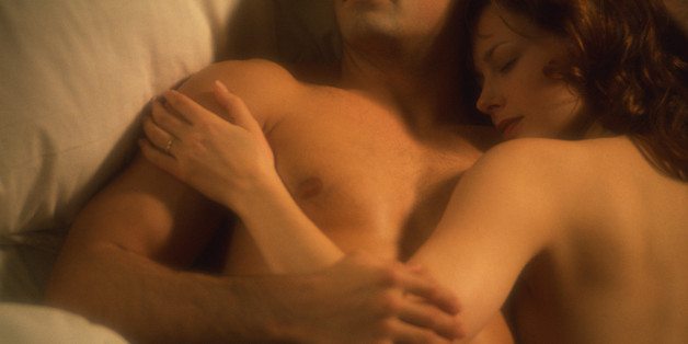 Loving couple relaxing in bed