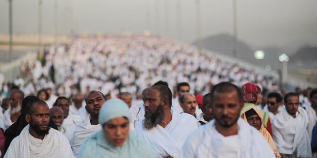 "Hundreds of thousands of Muslim pilgrims make their way to cast stones at a pillar symbolizing the stoning of Satan, in a ritual called ""Jamarat,"" the last rite of the annual hajj, on the first day of Eid al-Adha, in Mina near the holy city of Mecca, Saudi Arabia, Thursday, Sept. 24, 2015. Saudi Arabia's civil defense directorate says at least 150 people have been killed in a stampede at the annual hajj pilgrimage. (AP Photo/Mosa'ab Elshamy)"