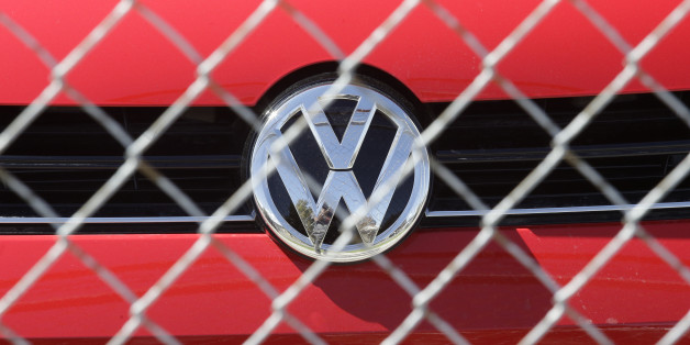 A Volkswagen diesel sits behind a security fence on a storage lot near a VW dealership Wednesday, Sept. 23, 2015, in Salt Lake City. Volkswagen CEO Martin Winterkorn resigned Wednesday, days after admitting that the world's top-selling carmaker had rigged diesel emissions to pass U.S. tests during his tenure. (AP Photo/Rick Bowmer)
