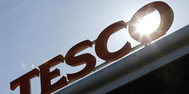 A Tesco logo is pictured at a supermarket in west London on April 22, 2015. Britain's biggest retailer, supermarket group Tesco, announced Wednesday that it had plunged massively into the red last year as it took a hit on the value of its property. AFP PHOTO / ADRIAN DENNIS        (Photo credit should read ADRIAN DENNIS/AFP/Getty Images)