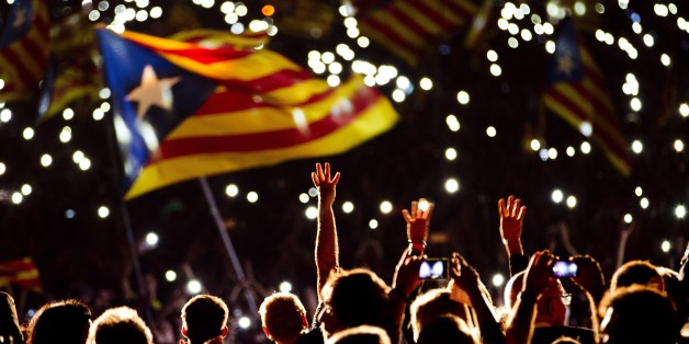 "Pro independence supporters wave ""estelada"" or pro independence flags during a rally of ""Junts pel Si"" or ""Together for YES"" in Barcelona, Spain, Friday, Sept. 25, 2015.  Catalans vote Sunday in regional parliamentary elections that the breakaway camp hopes will give them a mandate to put their region on a path toward independence _ a goal the Madrid central government says would be illegal.  (AP Photo/Emilio Morenatti)"