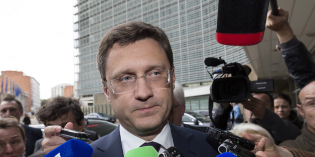 Russia's Energy Minister Alexander Novak, center, speaks with the media as he arrives in front of EU headquarters in Brussels on Friday, Sept. 25, 2015. Russia and Ukraine resumed talks on Friday in Brussels, aimed at trying to clinch a deal guaranteeing that Ukraine will receive shipments of Russian natural gas this winter. (AP Photo/Thierry Monasse)