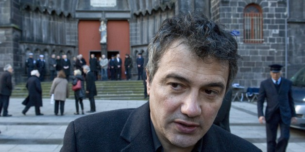 French doctor and contributor to French satirical magazine Charlie Hebdo, Patrick Pelloux, speaks to journalists in Clermont-Ferrand on January 14, 2015, after attending the funeral of Michel Renaud, who died on January 7 in the attack at the magazine's offices in Paris. Renaud was in attendance at the magazine's weekly editorial conference after returning cartoons given to him on loan by the magazine for an exhibition in Clermont-Ferrand. AFP PHOTO / THIERRY ZOCCOLAN        (Photo credit should read THIERRY ZOCCOLAN/AFP/Getty Images)