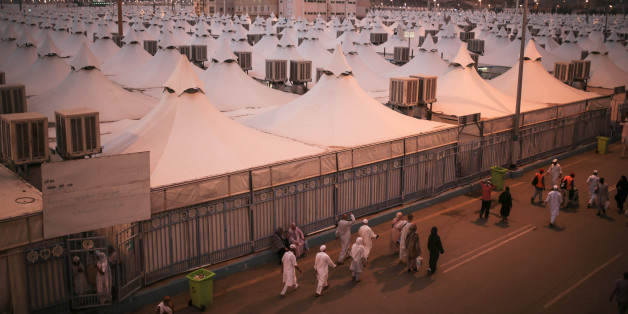 Muslim pilgrims walk past tents, a day after a stampede nearby killed more than 700 people, in Mina, near the holy city of Mecca, Saudi Arabia, Friday, Sept. 25, 2015. Saudi Arabia faced new accusations of neglect Friday in the hajj disaster that killed over 700 people, the second tragedy at this year's pilgrimage overseen by the kingdom's rulers who base their legitimacy in part on protecting Islam's holiest sites. (AP Photo/Mosa'ab Elshamy)