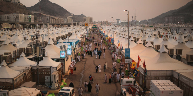 Muslim pilgrims walk past tents, a day after a stampede nearby in which more than 700 people died, in Mina, near the holy city of Mecca, Saudi Arabia, Friday, Sept. 25, 2015. Saudi Arabia faced new accusations of neglect Friday in the hajj disaster that killed over 700 people, the second tragedy at this year's pilgrimage overseen by the kingdom's rulers who base their legitimacy in part on protecting Islam's holiest sites. (AP Photo/Mosa'ab Elshamy)