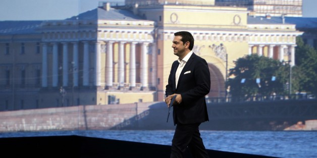 Greek Prime Minister Alexis Tsipras heads to speak at an economic forum in St. Petersburg, Russia, Friday, June 19, 2015. Russia is willing to consider giving financial aid to Greece, a Russian government official said Friday ahead of talks between the leaders of the two countries. (Valery Sharifulin/TASS News Agency Pool Photo via AP)