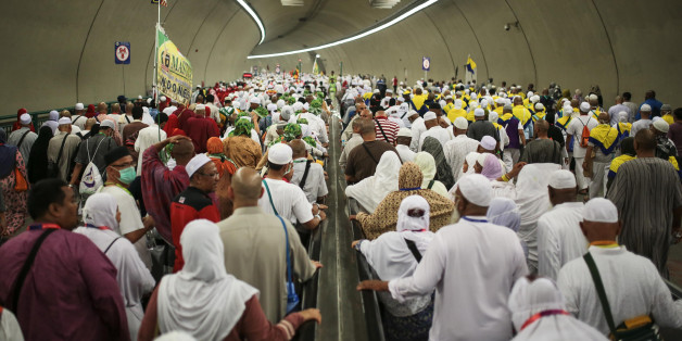 Muslim pilgrims walk in a tunnel on their way to cast stones at Jamarrat pillars, a ritual that symbolises the stoning of Satan, during the annual pilgrimage, known as the hajj, in Mina, near the holy city of Mecca, Saudi Arabia, Friday, Sept. 25, 2015. (AP Photo/Mosa'ab Elshamy)