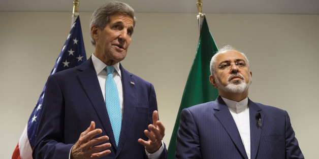 US Secretary of State John Kerry, left, speaks during a meeting with Iranian Foreign Minister Mohammad Javad Zarif at United Nations headquarters Saturday, Sept. 26, 2015. (AP Photo/Craig Ruttle)