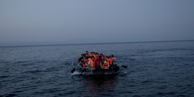 Syrian refugees arrive aboard a dinghy after crossing from Turkey, to the island of Lesbos, Greece, on Sunday, Sept. 20, 2015. Greece's coast guard was searching Sunday for 26 migrants missing off the coast of the eastern Aegean island of Lesbos after the boat they were traveling in sank.(AP Photo/Petros Giannakouris)