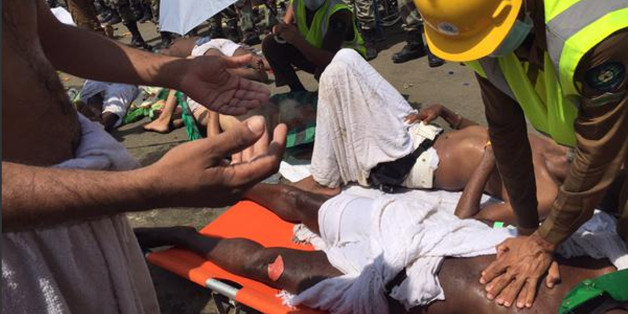 In this image posted on the official Twitter account of the directorate of the Saudi Civil Defense agency, a pilgrim is treated by a medic after a stampede that killed and injured pilgrims in the holy city of Mina during the annual hajj pilgrimage on Thursday, Sept. 24, 2015. (Directorate of the Saudi Civil Defense agency via AP) MANDATORY CREDIT