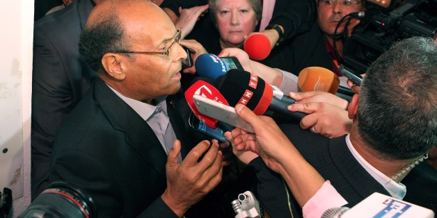 Presidential candidate and Tunisian President Moncef Marzouki addresses media after he casts his vote, during the first round of the Tunisian presidential election, in Sousse, Tunisia, Sunday, Nov. 23, 2014. Tunisia took another step forward in its peaceful transition to democracy on Sunday by holding its first free presidential election, with voters hoping for more stability and a better economy. (AP Photo/Ali Louati)