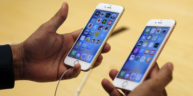 A customer tries out new Apple iPhone 6S at an Apple store on Chicago's Magnificent Mile, Friday, Sept. 25, 2015, in Chicago. (AP Photo/Kiichiro Sato)