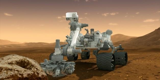 Vue d'artiste fournie par la Nasa le 1er août 2012, qui montre le robot Curiosity, chargé de découvrir des preuves de possibilité de vie sur Mars