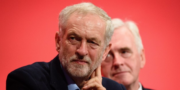 Leader of the opposition Labour Party Jeremy Corbyn (L) sits by shadow chancellor John McDonnell on day two of the annual Labour party conference in Brighton on September 28, 2015. AFP PHOTO / LEON NEAL        (Photo credit should read LEON NEAL,LEON NEAL/AFP/Getty Images)