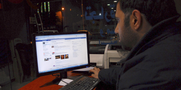 A Syrian man  connects on his Facebook account at an internet cafe, in Damascus, Syria, on Tuesday Feb. 8, 2011. A media watchdog said Tuesday that Syria appears to be lifting a three-year-old ban on YouTube and Facebook, a decision that could be seen as a gesture to stave off unrest following popular uprisings in Egypt and Tunisia. The Syrian government does not comment on its Internet restrictions. But several Internet users in Syria told The Associated Press on Tuesday that the sites were acc