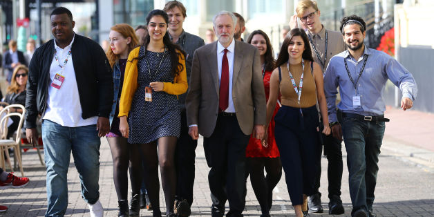 Jeremy Corbyn arriving with supporters at the Brighton Centre in Brighton, Sussex to make his first speech as leader to the Labour Party conference at the Brighton Centre in Brighton, Sussex.
