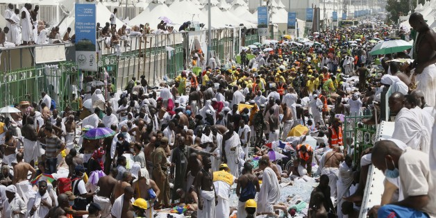 Muslim pilgrims and rescuers gather around people who were crushed by overcrowding in Mina, Saudi Arabia during the annual hajj pilgrimage on Thursday, Sept. 24, 2015. Hundreds were killed and injured, Saudi authorities said. The crush happened in Mina, a large valley about five kilometers (three miles) from the holy city of Mecca that has been the site of hajj stampedes in years past. (AP Photo)