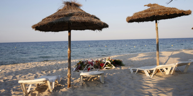 Lounge chairs and numerous flowers laid out at the scene of the attack in Sousse, Tunisia, Sunday, June 28, 2015. The Friday attack on tourists at a beach is expected to be a huge blow to Tunisia's tourism sector, which made up nearly 15 percent of the country's gross domestic product in 2014. (AP Photo/Abdeljalil Bounhar)